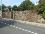 Front wall on approach from junction with N25